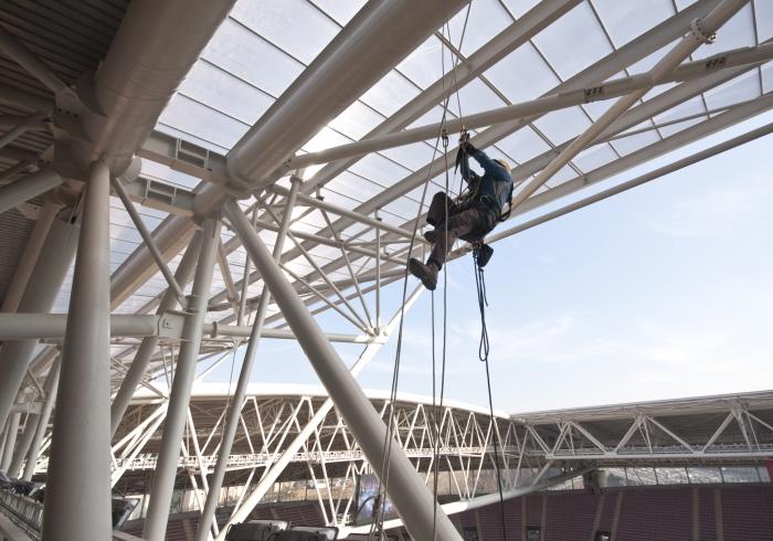 worker climbs